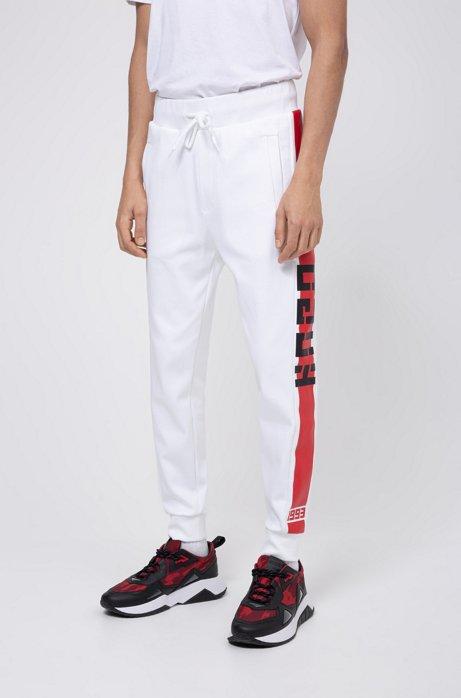 Pantalon en jersey interlock, avec rayure contrastante sur le côté, Blanc