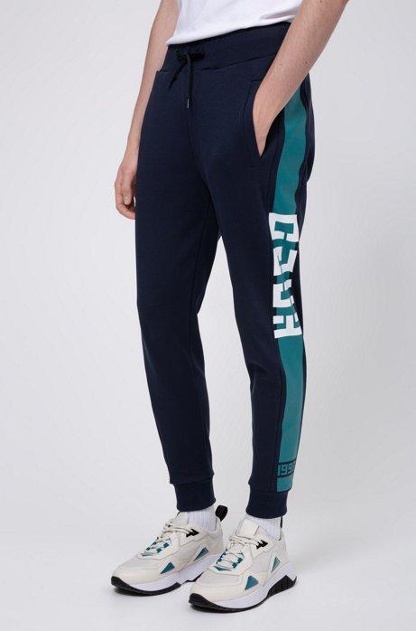 Pantalon en jersey interlock, avec rayure contrastante sur le côté, Bleu foncé
