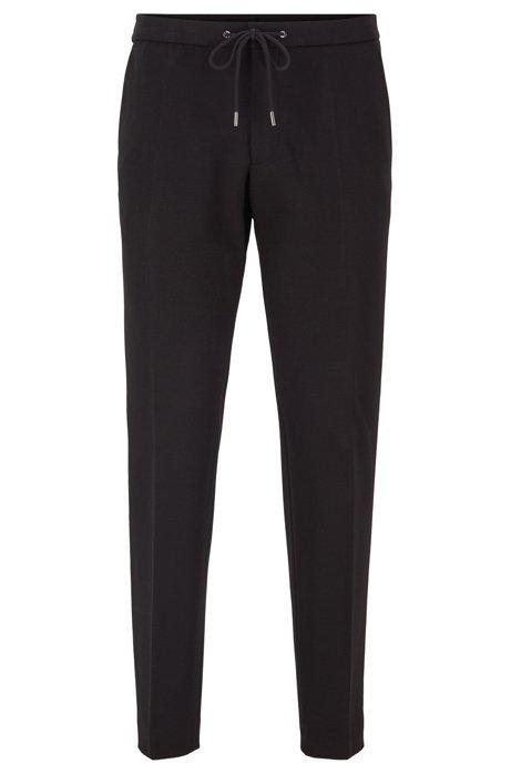 Pantaloni slim fit in tessuto elasticizzato con vita elastica, Nero