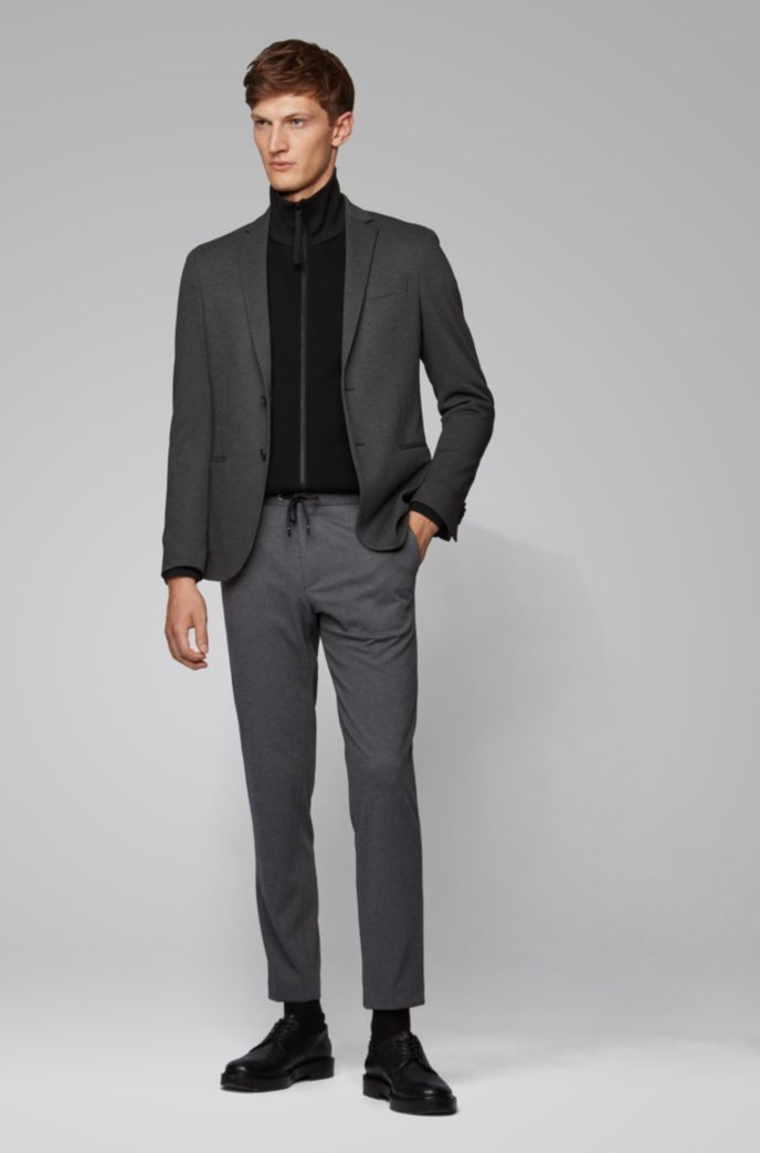 Pantaloni slim fit in tessuto elasticizzato con elastico in vita