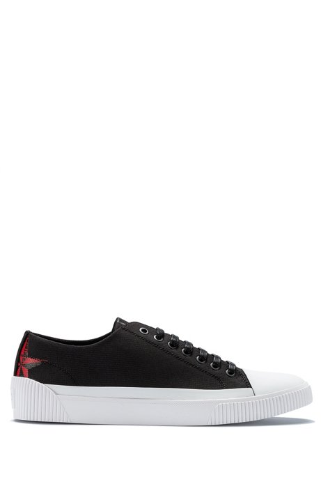 Low-top trainers in ripstop nylon with seasonal artwork, Black