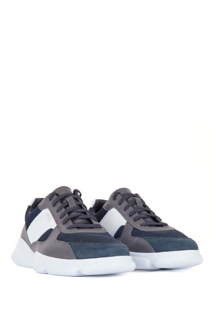 Low-top trainers in leather with open-mesh panels