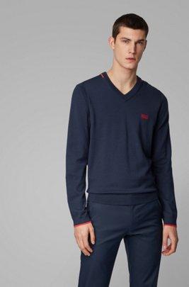 Maglione regular fit con scollo a V e dettagli a contrasto, Blu scuro