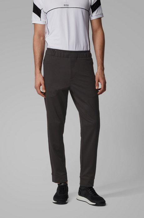 Tapered-fit trousers in stretch jersey with logo detailing, Black