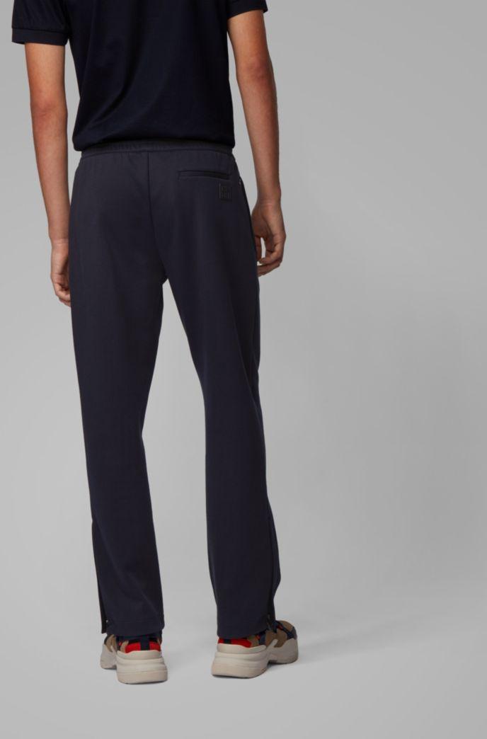 Pantalon de survêtement en coton mélangé avec galon sur le côté