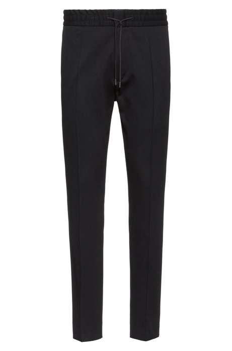 Pantaloni con fit affusolato in twill di jersey con coulisse, Nero