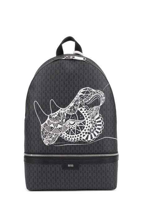 Monogram-print backpack in coated fabric with collection artwork, Black