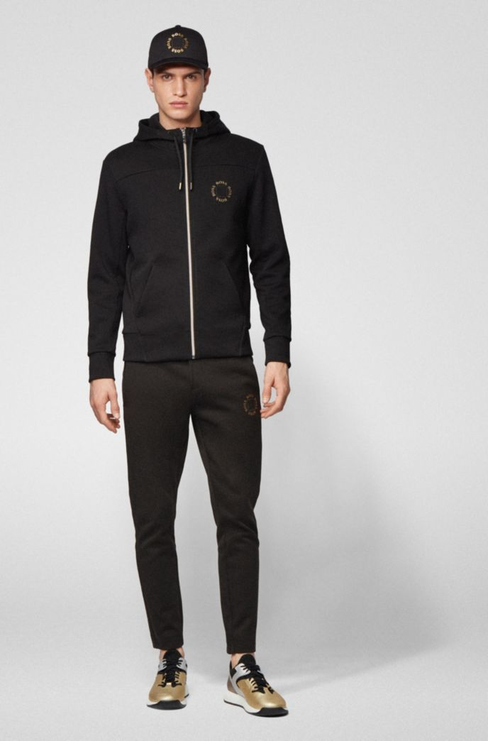 Regular-fit jogging trousers with layered metallic logo