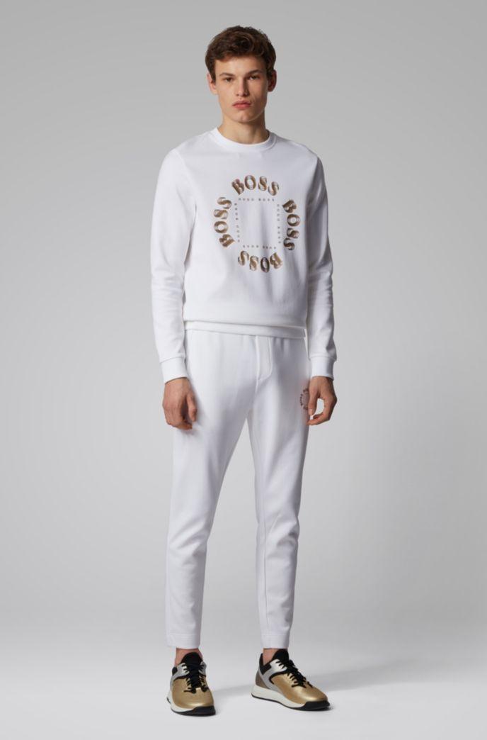 Pantalon de survêtement Regular Fit avec logo métallisé à effet superposé