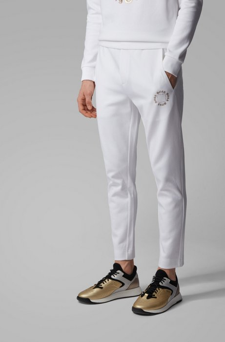 Regular-fit jogging trousers with layered metallic logo, White