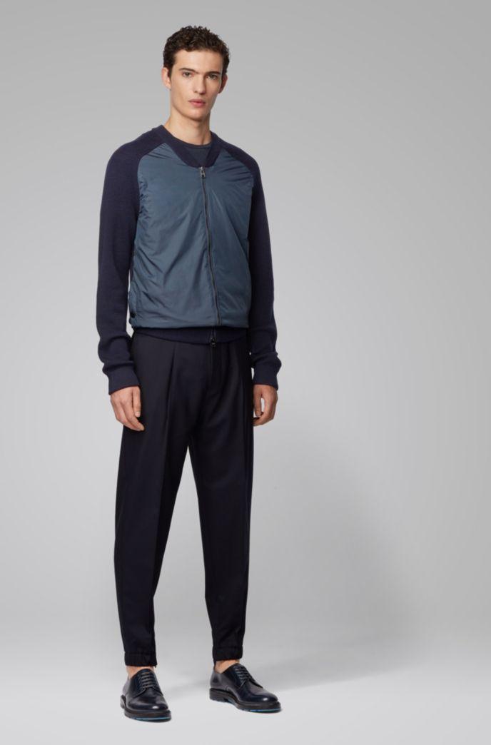Veste zippée avec manches côtelées et détails colorés