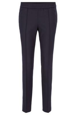 Pantaloni relaxed fit in crêpe elasticizzato con riga laterale, Blu scuro