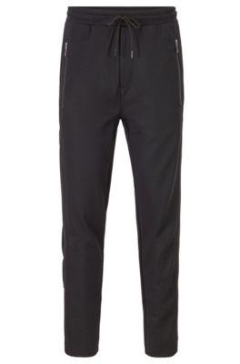 Pantalon de survêtement Regular Fit avec boutons-pression sur les coutures latérales, Noir