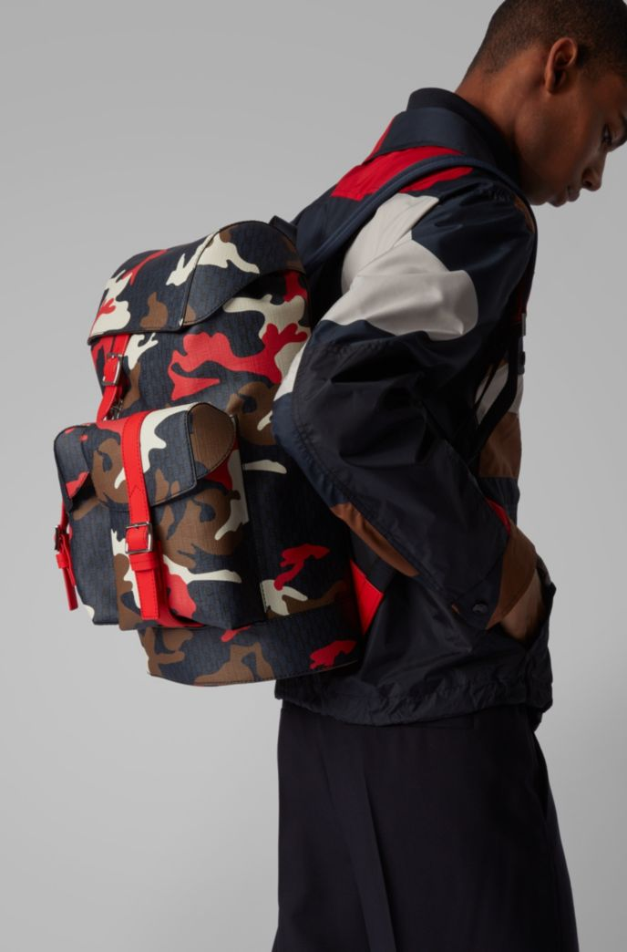 Camouflage-print backpack with all-over monograms