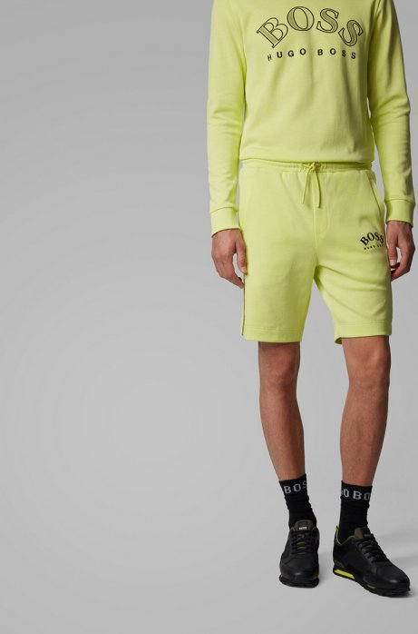 Slim-fit shorts with contrast details and curved logo, Light Green