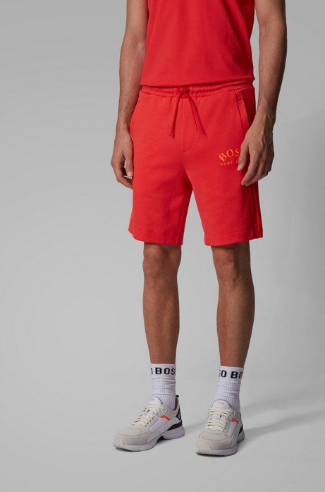Slim-fit shorts with contrast details and curved logo, Red