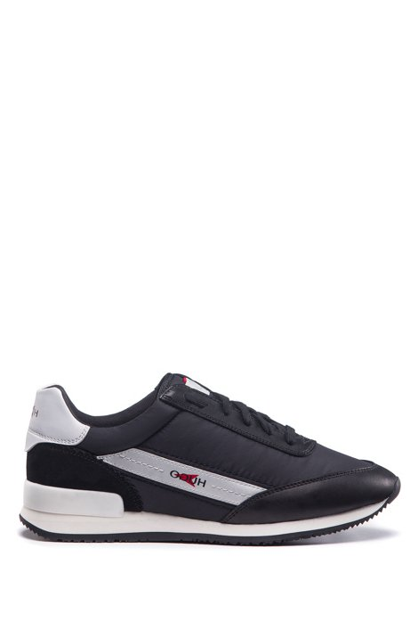 Running-style trainers in mixed materials with reverse-logo branding, Black