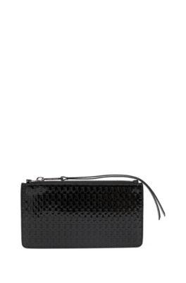 Reise-Geldbörse aus Lackleder mit Reißverschluss und geprägtem Monogramm, Schwarz