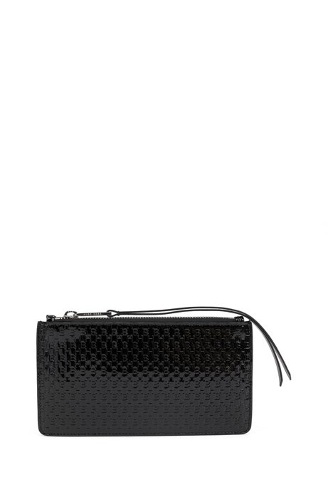 Zipped travel wallet in monogram-embossed patent leather, Black