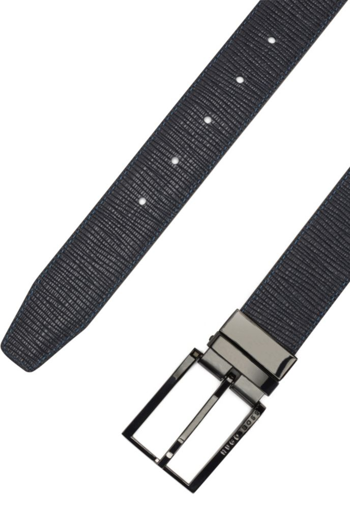 Reversible belt in plain and structured leather with dual buckles