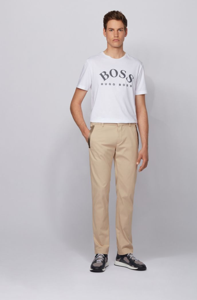 Slim-fit trousers in a cotton blend with taped pockets