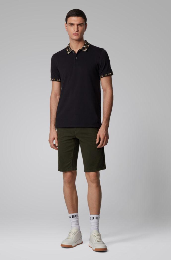 Poloshirt aus elastischer Baumwolle mit Muster an Kragen und Ärmelbündchen