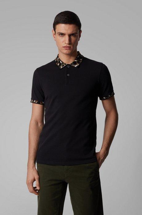 Poloshirt aus elastischer Baumwolle mit Muster an Kragen und Ärmelbündchen, Schwarz