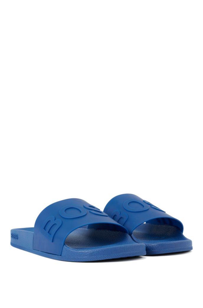 In Italien gefertigte Slides mit Logo-Riemen und konturiertem Fußbett