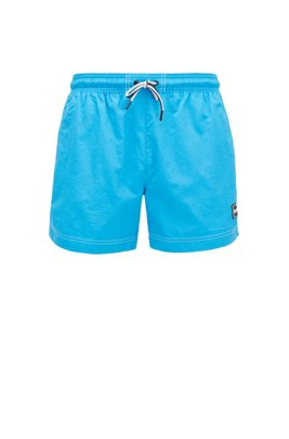 Quick-drying swim shorts with rubber logo badge, Blue