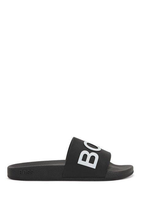 Slippers met logoband en gegoten voetbed, Zwart