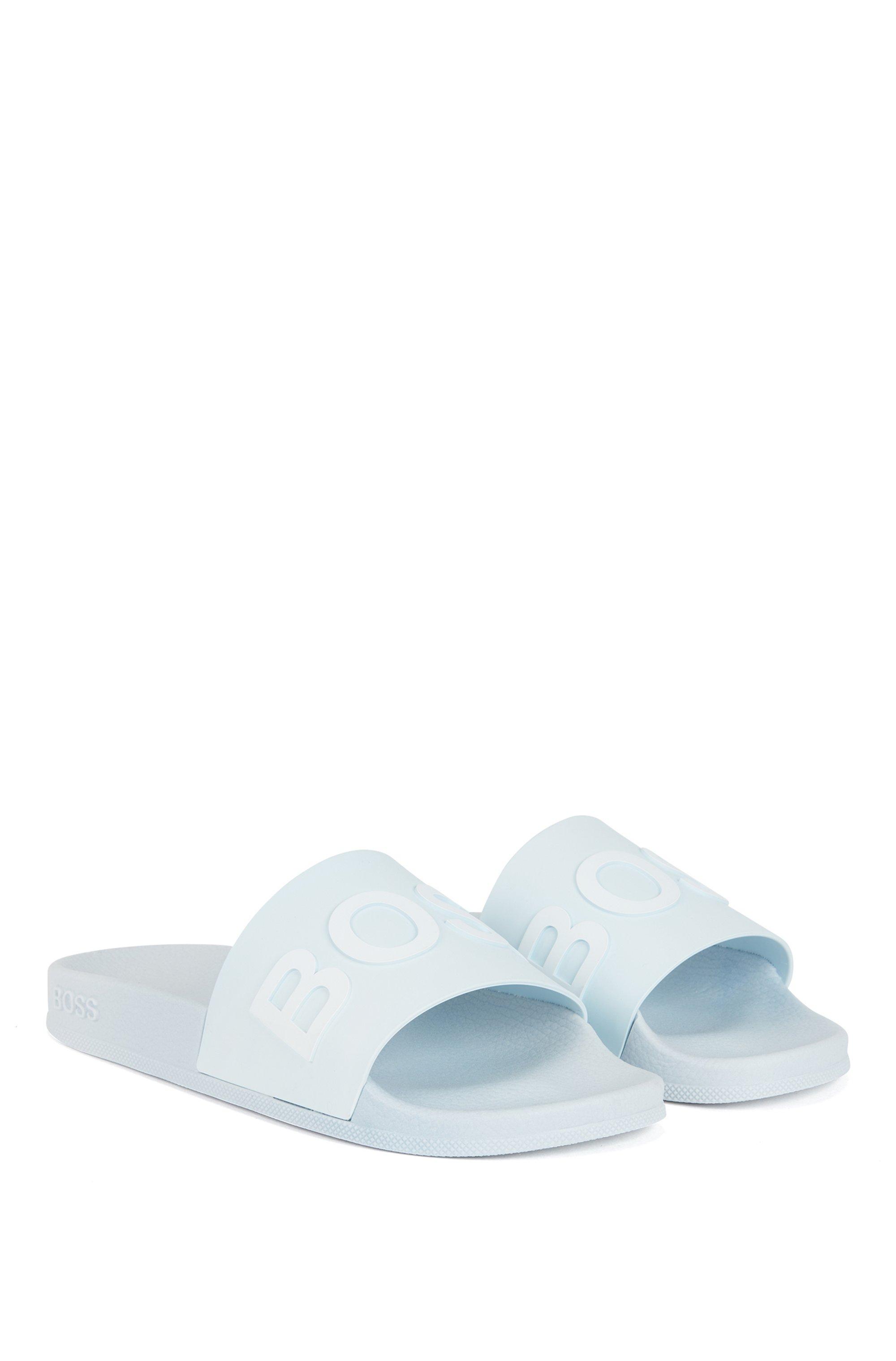 Slippers met logoband en gegoten voetbed