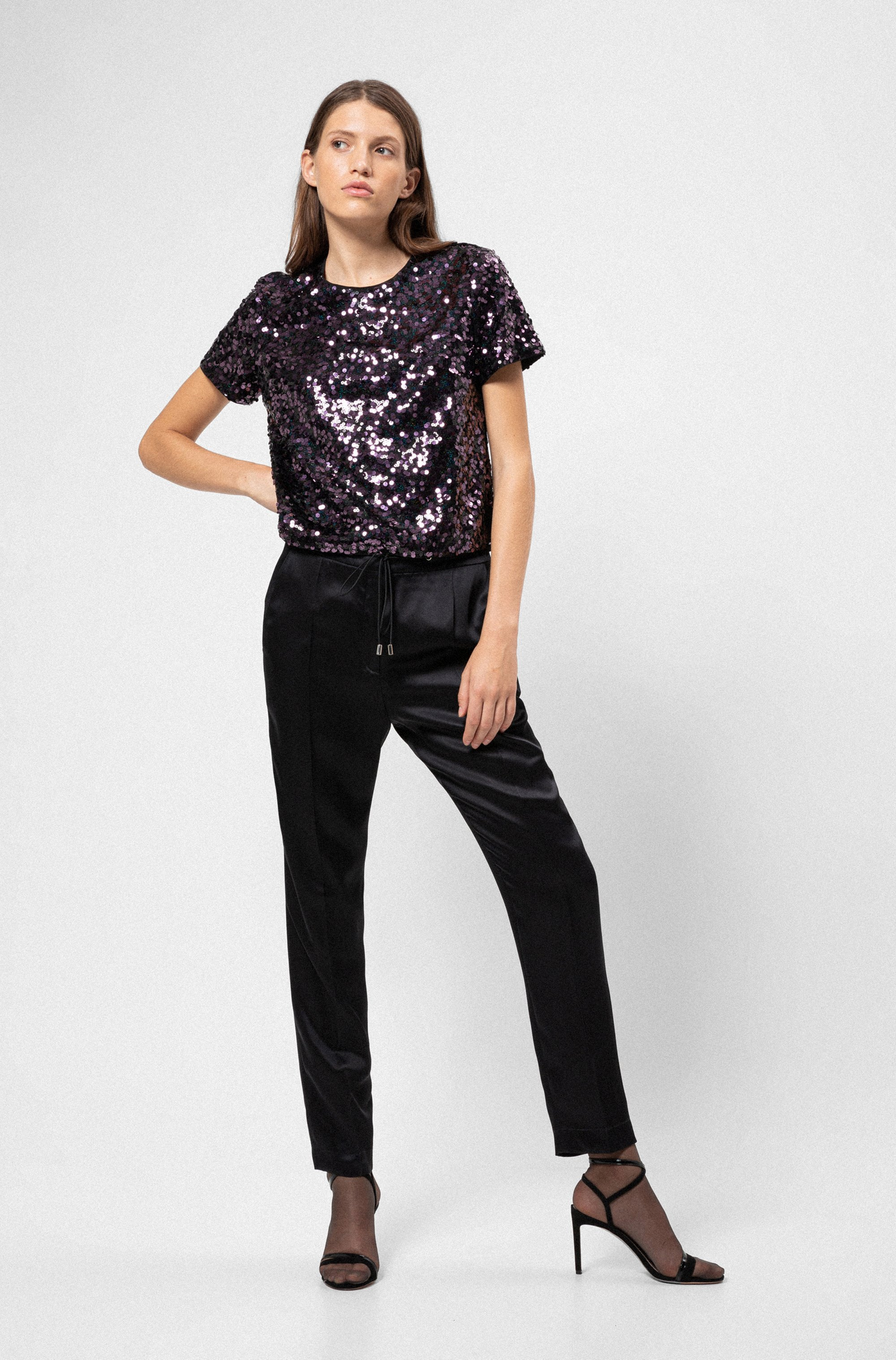 Relaxed-fit jogging trousers in lustrous fabric