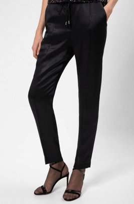 Relaxed-fit jogging trousers in lustrous fabric, Black
