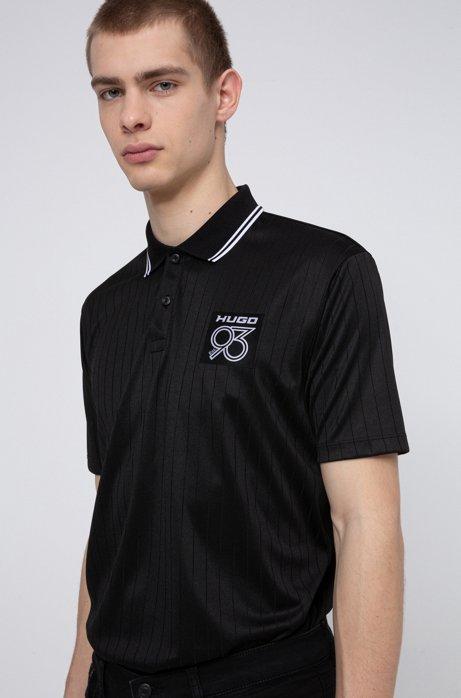 Poloshirt mit Nadelzugstreifen und Logo-Patch, Schwarz