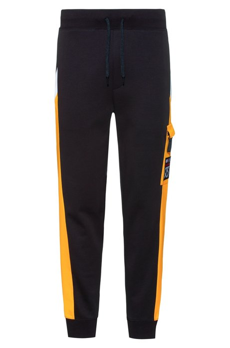 Jogging trousers with side panels and patch pocket, Black