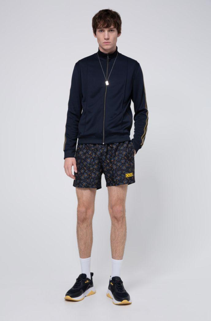 Quick-drying swim shorts with tulip print