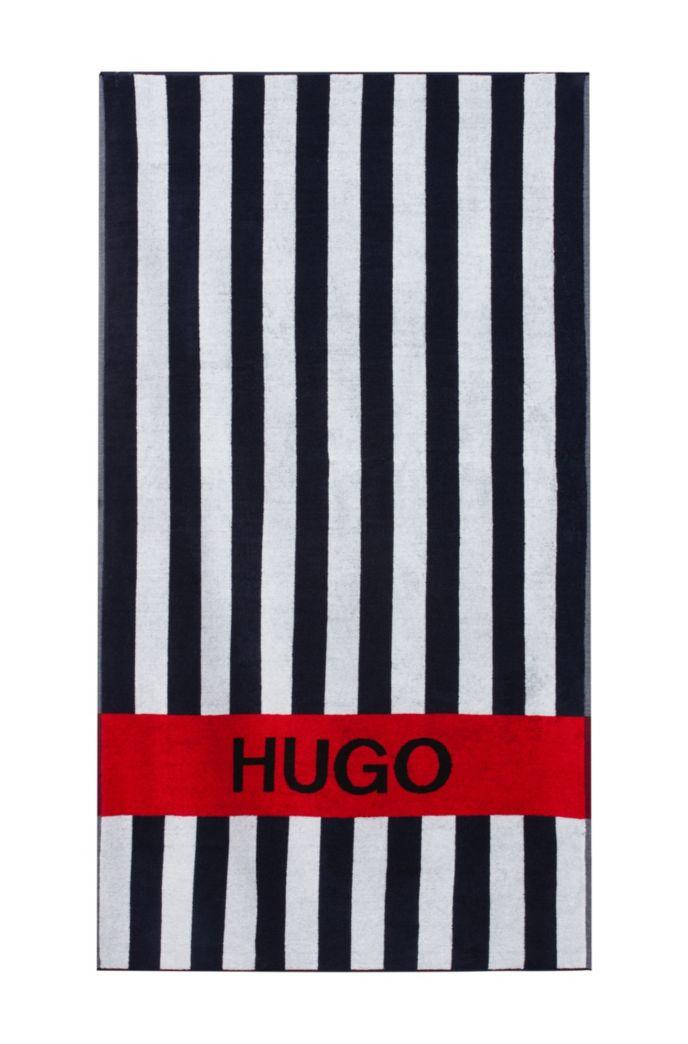 Gestreiftes Badetuch aus Baumwoll-Terry mit kontrastfarbenem Logo