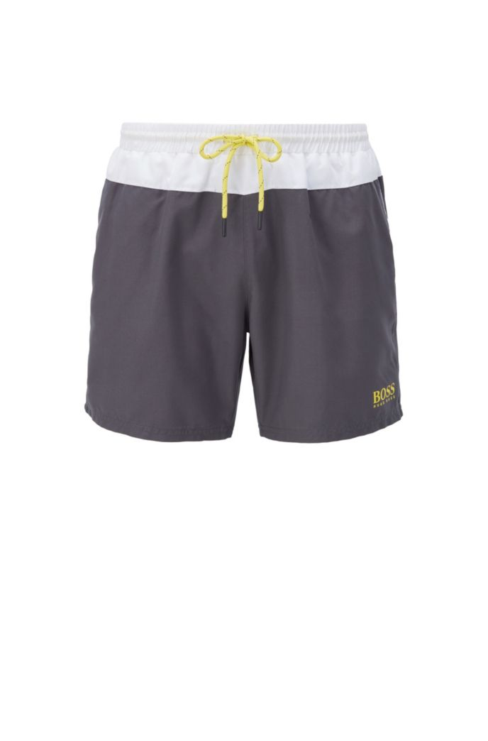 Logo beach set comprising towel, swim shorts and bag