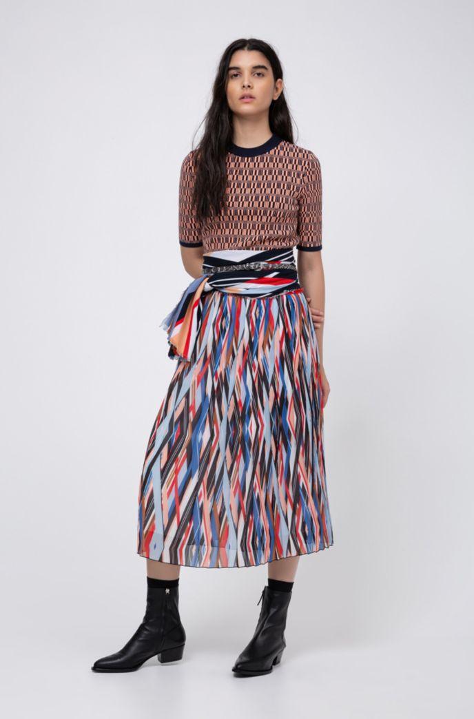 Jupe plissée mi-longue à imprimé à rayures en zigzag