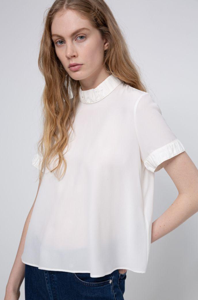 Regular-Fit Bluse aus sandgewaschener Seide mit Knopfleiste hinten