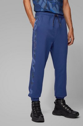 Pantaloni da jogging regular fit in french terry con stampa con algoritmo, Blu scuro