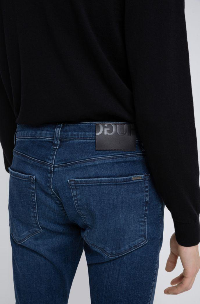 Skinny-fit jeans van middelblauw gelaserd stretchdenim