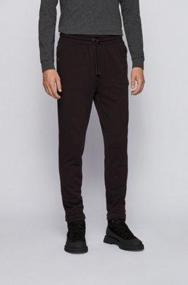 Pantalon Relaxed Fit en molleton de coton avec finitions en gomme, Noir