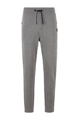 Pantaloni relaxed fit in cotone terry con rifiniture in gomma, Grigio chiaro