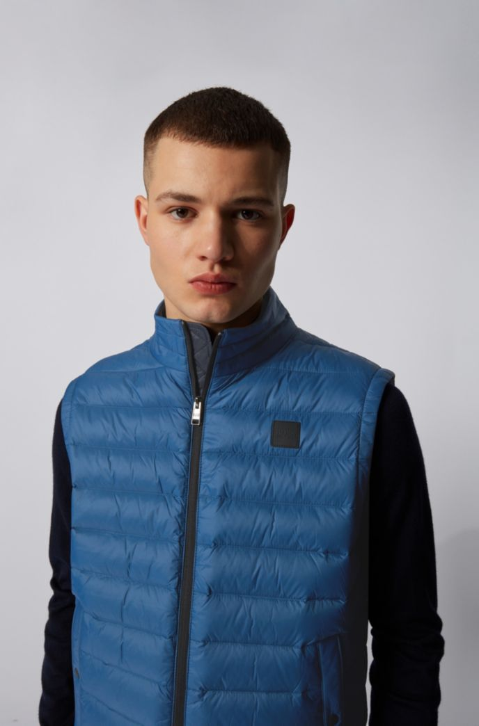 Packable down gilet in water-repellent fabric