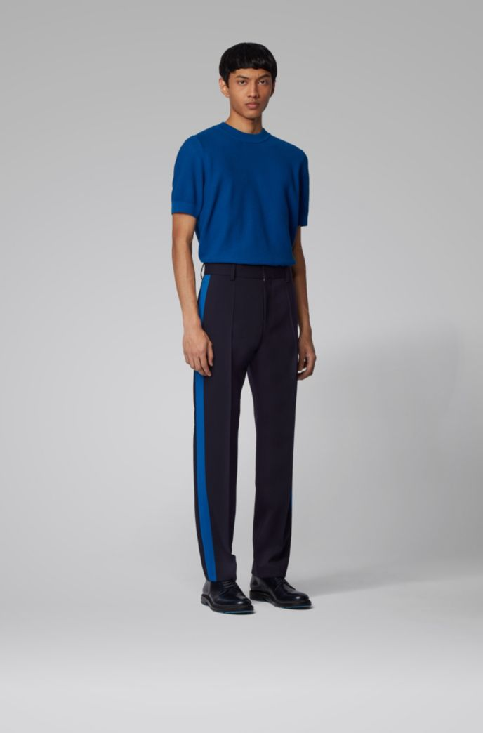 Pantaloni relaxed fit in lana elasticizzata con cuciture laterali a contrasto