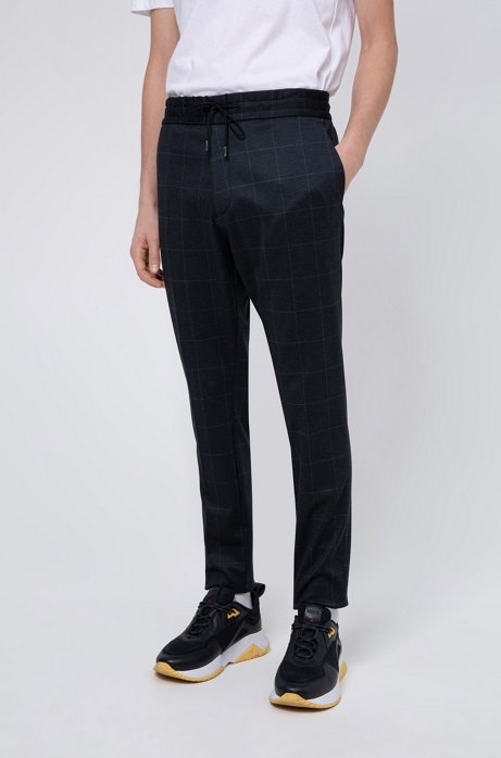 Tapered-fit trousers in check-print stretch jersey, Dark Blue