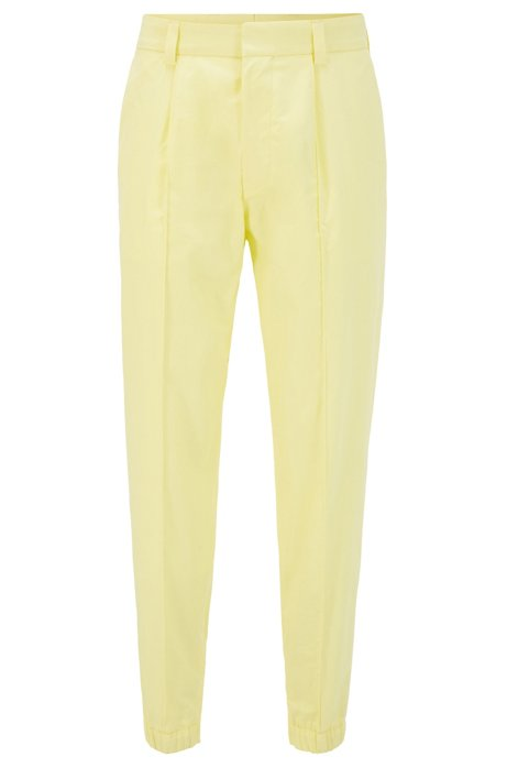 Cotton tapered-fit trousers with zip-detail cuffed hems, Yellow