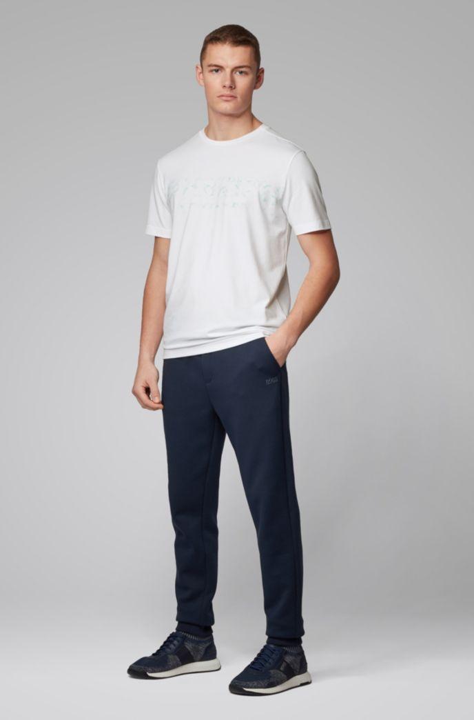 T-shirt en coton stretch à logo imprimé réagissant aux UV