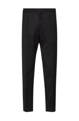 Pantalones extra slim fit en sarga elástica con cintura elástica, Negro